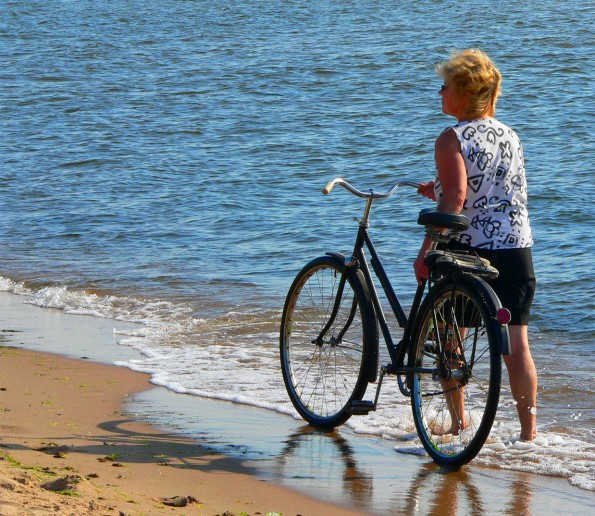 woman at beach with bike