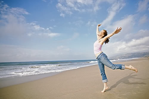 woman-beach-dancing